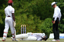 An injured Rayad Emrit lies on the ground, Trinidad & Tobago v Leeward Islands, Regional 4-Day Tournament, 3rd day, Couva, February 28, 2016