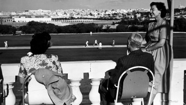 Spectators watch cricket from the pavilion at Marsa Cricket Club in Malta