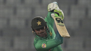 Shoaib Malik punches down the ground