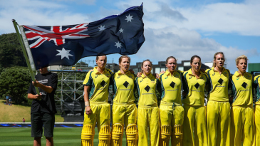 The Australia Women players sing the national anthem