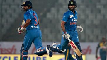 Suresh Raina and Virat Kohli steered India's chase with a 54-run, third-wicket partnership