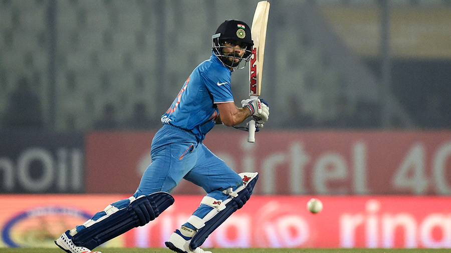 Virat Kohli looks on after playing the ball on the off side