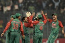 Bangladesh mob Arafat Sunny to celebrate a wicket, Bangladesh v Pakistan, Asia Cup 2016, Mirpur, March 2, 2016