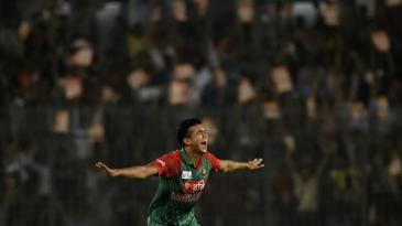 Taskin Ahmed shows his delight after taking a wicket