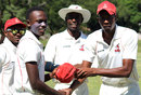 Brandon Mavuta gets his first-class cap from Remembrance Nyathi, Mid West Rhinos v Matabeleland Tuskers, Logan Cup, Bulawayo, March 2, 2016