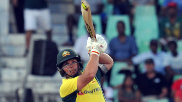 Aaron Finch hits down the ground during his 18-ball 40