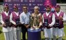 Former India cricketers Sameer Dighe and Diana Edulji  and Mumbai dabbawalas pose with the World T20 trophies, Mumbai, March 6, 2016
