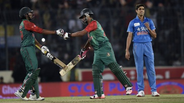 Tamim Iqbal and Soumya Sarkar touch bat and gloves during their opening stand