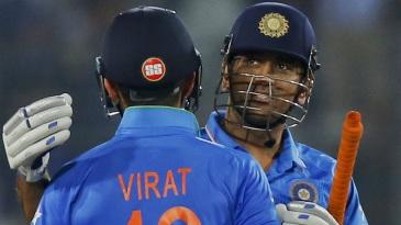 MS Dhoni hugs Virat Kohli after sealing India's victory