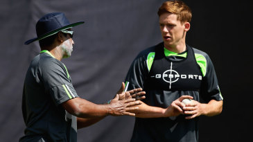 Bowling consultant Chaminda Vaas speaks to Craig Young during a training session