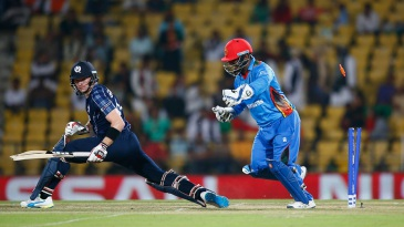 Mohammad Shahzad takes the bails off as Richie Berrington is stumped