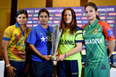 Team captains Shashikala Siriwardene, Mithali Raj, Isobel Joyce and Jahanara Alam pose with the Women's World T20 trophy, Bangalore, March 9, 2016