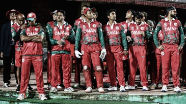 Oman players wait to take the field