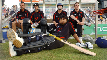 Mushtaq Ahmed and the Sussex side watch the match from the dugout