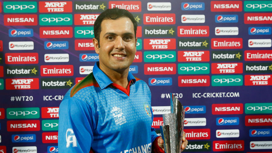 Mohammad Nabi poses with the Man of the Match trophy