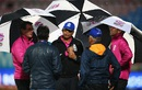 Match umpires have a chat with the groundstaff as rain stops play, Bangladesh v Ireland, World T20 qualifier, Group A, Dharamsala, March 11, 2016
