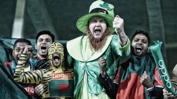An Ireland fan joins his Bangladesh counterparts