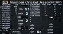 Scorers catch a glimpse of the action through the empty spaces of the scoreboard, New Zealand v England, World T20 Warm-ups, Mumbai, March 12, 2016