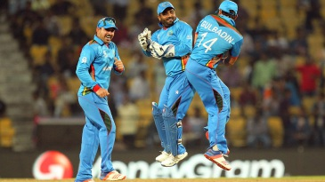Mohammad Shahzad and Gulbadin Naib celebrate after Afghanistan qualified to the main draw