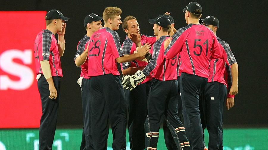 Scotland celebrate a wicket