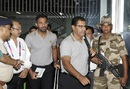 Wahad Riaz and Waqar Younis make their way out of the Kolkata airport, March 12, 2016