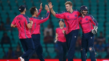 Gavin Main celebrates a wicket with his team-mates