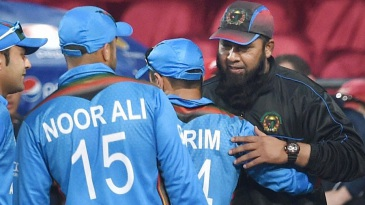 Inzamam-ul-Haq greets the Afghanistan players after the win