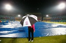 A match official inspects the ground during a rain break, Hong Kong v Scotland, World T20 qualifiers, Group B, Nagpur, March 12, 2016