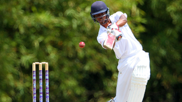 Roston Chase plays a drive during his knock of 59