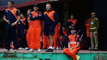 Netherlands' players look on from the dressing room during the rain interruption