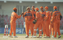 Nolan Clarke congratulates Jan Bakker for his wicket of Alec Stewart, England v Netherlands, Group B, World Cup, Peshawar, February 22, 1996