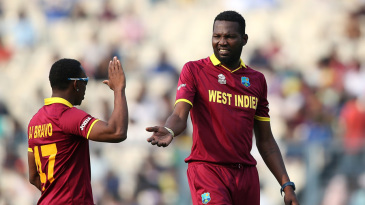 Sulieman Benn is congratulated after picking up a wicket
