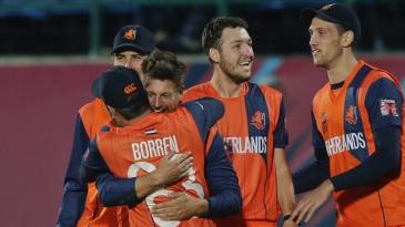 Netherlands players celebrate a wicket
