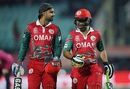 Jatinder Singh and Adnan Ilyas walk off as rain stops play, Bangladesh v Oman, World T20 qualifiers, Group A, Dharamsala, March 13, 2016