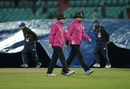 Chris Gaffaney and Rod Tucker leave the field as the covers come on, Bangladesh v Oman, World T20 qualifiers, Group A, Dharamsala, March 13, 2016