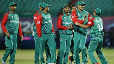Bangladesh players celebrate their win over Oman
