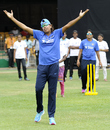 Jhulan Goswami reacts while playing with locals, Bangalore, March 14, 2016