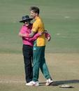 Dale Steyn hugs on-field umpire Anil Dandekar, Mumbai Cricket Association XI v South Africa, World T20 warm-ups, Mumbai, March 15, 2016