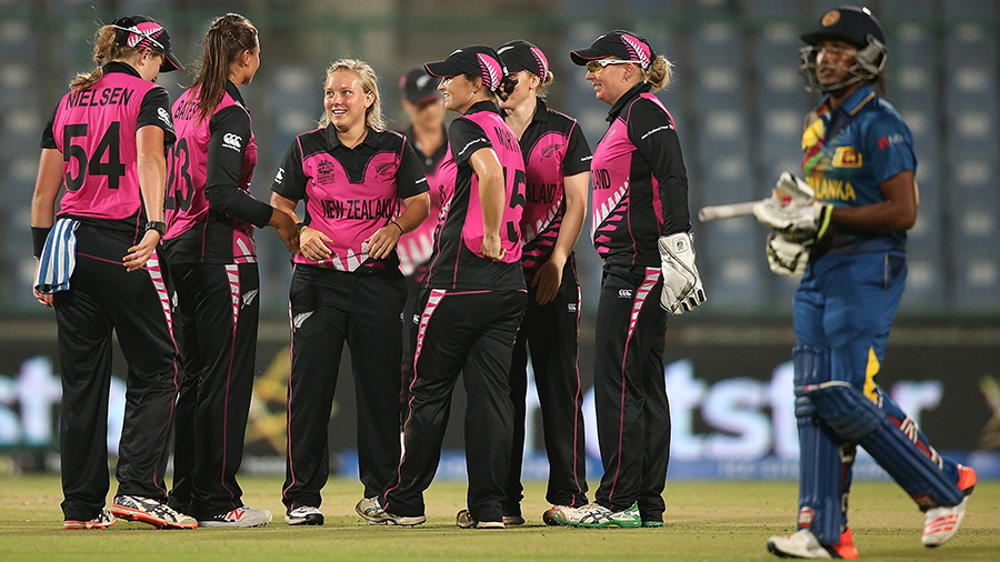 Leigh Kasperek celebrates with her team-mates after dismissing Chamari Atapattu