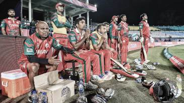Oman team members look on from the dugout