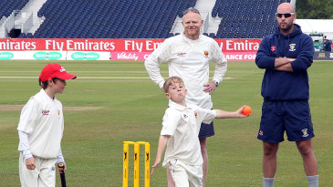 Kids take part in a coaching session with Durham's Chris Rushworth