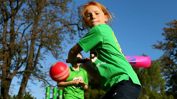 Kids play cricket during the Women's BBL launch