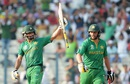 Mohammad Hafeez celebrates his half-century as Shahid Afridi looks on, Bangladesh v Pakistan, World T20 2016, Group 2, Kolkata, March 16, 2016
