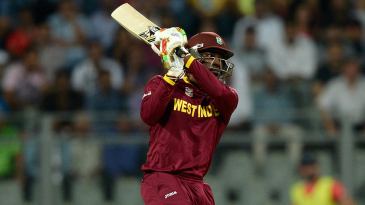 Chris Gayle smacks a six down the ground