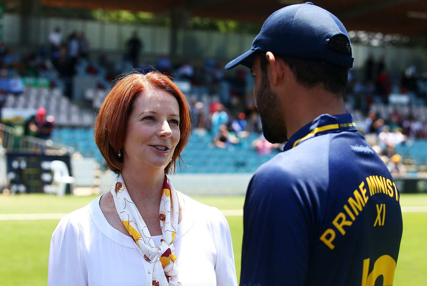 One of us: with Prime Minister Julia Gillard on the sidelines of a game against the touring West Indians in Canberra, 2013