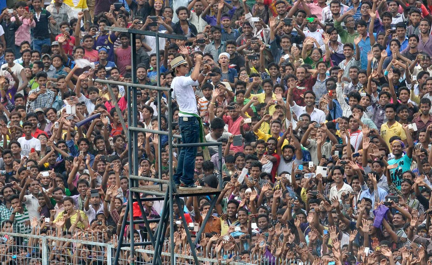 Shahrukh Khan waves to the crowd during a  ceremony to honour the IPL champions Kolkata Knight Riders