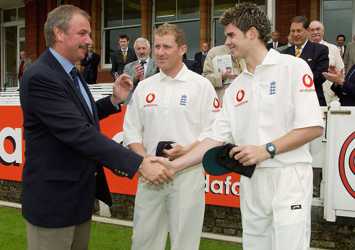 James Anderson receives his England cap from David Graveney