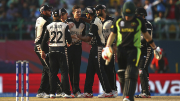 Mitchell Santner is congratulated after dismissing Steven Smith