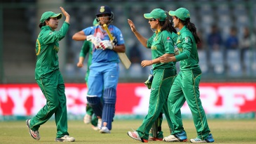 Sana Mir celebrates with her team-mates after dismissing Veda Krishnamurthy