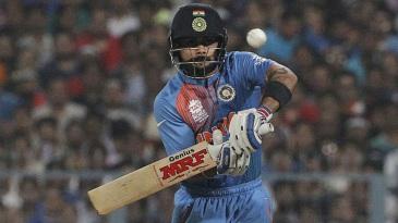 Virat Kohli defends off the back foot